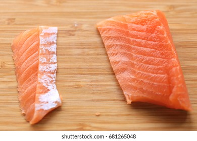 Salmon sliced for nigiri sushi