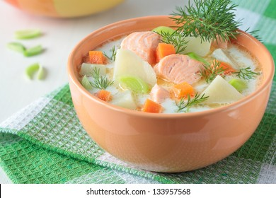 Salmon soup with cream, potatoes, carrots, dill
