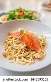 Salmon spaghetti. pasta salmon on the table.