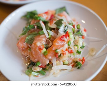 Salmon Spicy Salad with Herbs. Mix Japanese and Thai food between Salmon sashimi and Thai herb. Can eat all day.