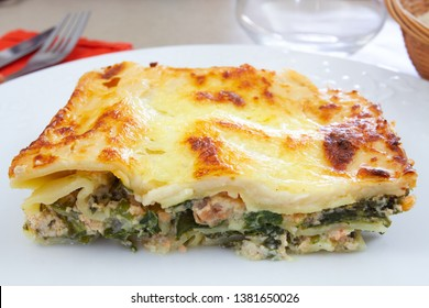 salmon and spinach lasagna on a plate