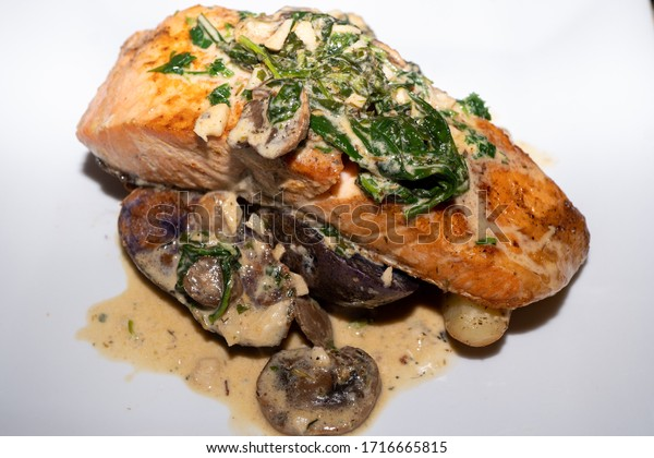 Salmon with Spinach over Purple, Red, and Gold Fingerling Potatoes in a Mushroom Cream Sauce