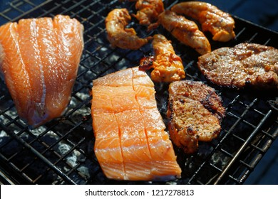 Salmon stake frying outside on the fire