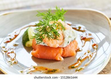Salmon starter dish with prawns