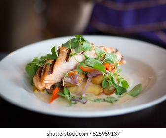 Salmon steak with chips.