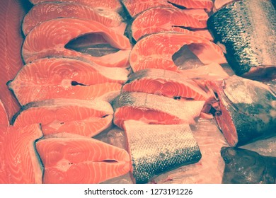 Salmon steak at famous fish market Kristiansand, Norway. Retro filtered color style.