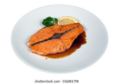 Salmon Steak Gravy Dressing Sauce with Lemon Slice and Parsley Leaf on White Dish