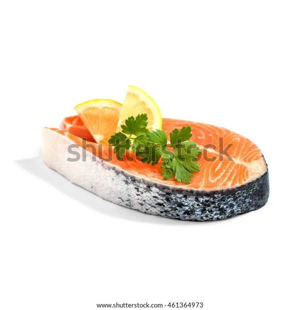 Salmon steak with lemon slice and parsley, isoliert