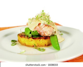 Salmon steak on pineapple with alfalfa sprouts and cottage cheese