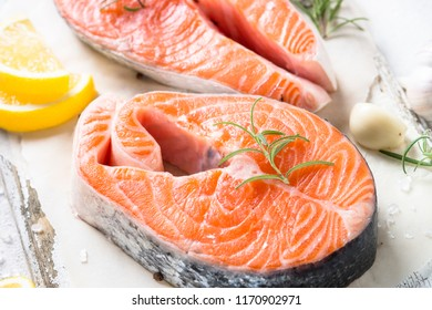 Salmon steak raw fish prepared for cooking. Close up.