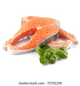 Salmon steak red fish decorated with basil