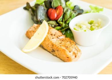 salmon steak with salad and apple cream sauce