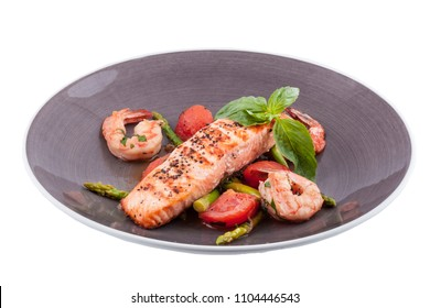 salmon steak with shrimps and asparagus