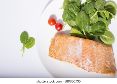 Salmon Steak with Spinach Leaves and Fresh Cherry Tomatoes