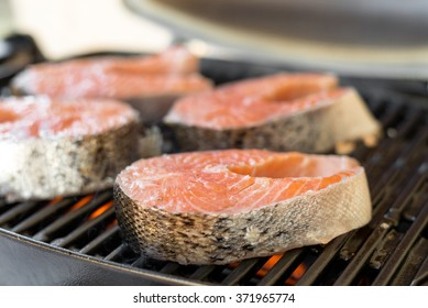 Salmon steaks barbeque cooking on grill