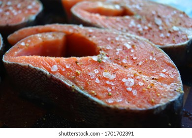 Salmon steaks in spices and salt