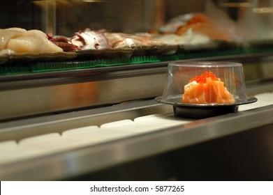 Salmon sushi in a conveyor belt sushi restaurant