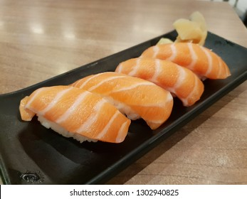 Salmon sushi, Japanese dish of prepared vinegared rice topped with fresh salmon