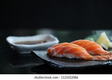 Salmon sushi on black plate japanese food