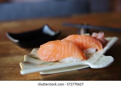 Salmon Sushi on wood background