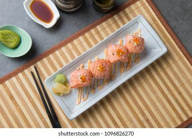 salmon sushi roll flat lay