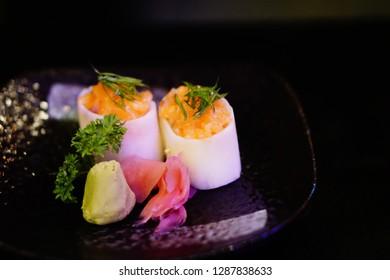 Salmon sushi, Salmon sa-shi-mi, a dish of salmon sushi, Japanese food served at Japanese restaurant in Vietnam