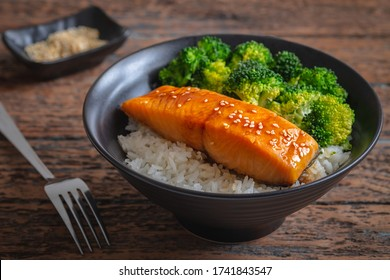 Salmon teriyaki with rice and vegetable in bowl
