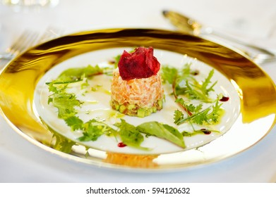 Salmon terrine starter on a white plate