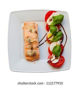 Salmon with tomatoes and basil. Greece. The view from the top. White background.