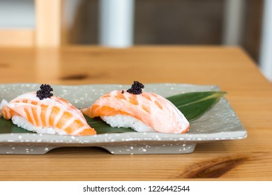 Salmon Toro Sushi In Grey Plate On Wooden Table With Copy Space.