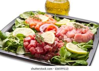 salmon, tuna and swordfish tartar with fresh salad