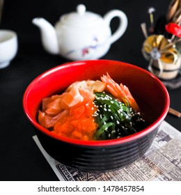 Salmon, Wakame salad or seaweed, eeg and ebiko with rice bowl or donburi in Japanese style food.