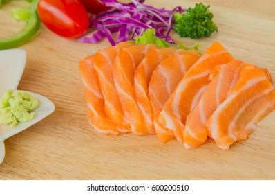 Salmon and wasabi on wood table