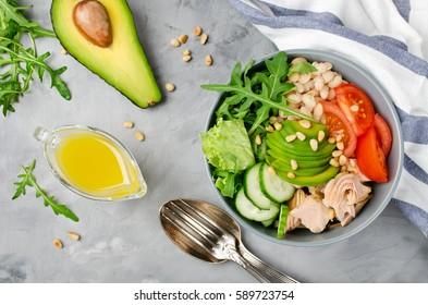Salmon with white bean, arugula and avocado salad. Healthy eating