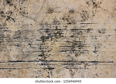 Salmon-pink-colored concrete wall texture with long horizontal scratches or scrape marks.