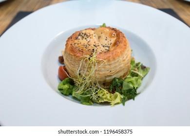Salmorejo with tuna tartare, pansy flower and salad vinaigrette with soya sauce and salvia