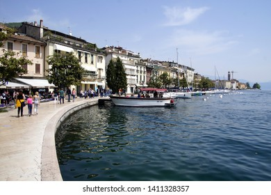 Salo, Italy - April 22, 2019: Unidentified participants walking along the promenade of Salo, Italy - Europe.
