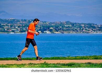 Salo, Italy - March 30, 2019: Man on a morning run