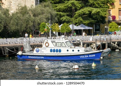 SALO, ITALY - SEPTEMBER 2018: Boat for divers of the volunteer force moored n Salo on Lake Garda.