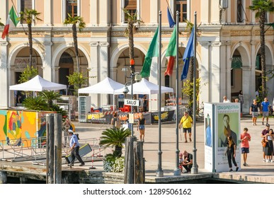 SALO, ITALY - SEPTEMBER 2018: Ferry landing point in the town of Salo on Lake Garda.
