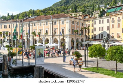 SALO, ITALY - SEPTEMBER 2018: People queuing for a fery on the lakefront of Salo on Lake Garda.