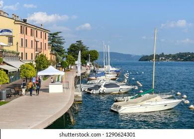 SALO, ITALY - SEPTEMBER 2018: People walking along the promenade in Salo on Lake Garda.