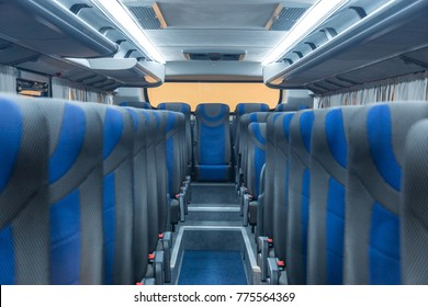Salon intercity bus inside. Gray-blue seats
