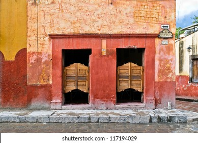 Saloon with swinging doors in Mexico on a colorful cobblestone street
