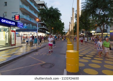 Salou, Spain - August 13, 2017: Salou is one of the largest tourist cities in Spain. In the evening lights turn on in the city.