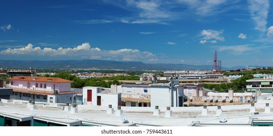 Salou, Spain - August 13, 2017: Salou is one of the largest tourist cities in Spain.Above the roofs are the slides of the entertainment parks of Port Aventura and Ferrari Land.