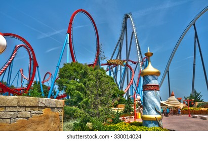 Salou, Spain - July 18, 2015: Dragon Khan and Shambhala attractions in PortAventura, is a theme park and a resort in the south of Barcelona, in Salou, Tarragona.