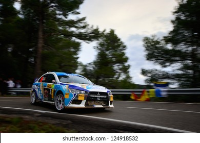 SALOU, SPAIN - NOV 10 : Spanish driver Yeray Lemes and his codriver Rogelio Peate in a Mitsubishi Lancer Evo X race in Rally of Spain, on Nov 10, 2012 in Salou, Spain