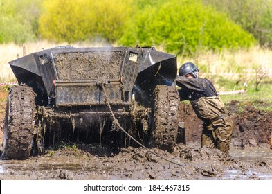 "SALOVKA, RUSSIA - MAY 5, 2017: Extreme competitions of all-wheel drive cars in the marshes at the annual car racing ""Trophy rubezh 2017"""