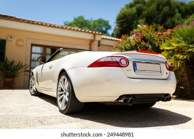 S'Alqieria Blanca, Mallorca, Spain, July 21 2014: White car in the sunny courtyard